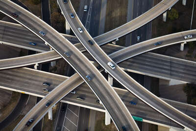 curated aerial photography : Inverted Cloverleaf interchange RT1 and RT183, Austin, Texas by Alex Maclean