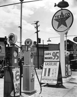 curated black and white art: Gasoline station, Bronx by Berenice Abbott