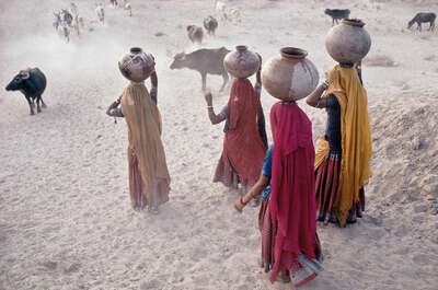 women collecting water, No 2, Rajasthan by Christopher Pillitz