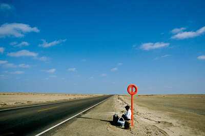 bus stop in the desert, Peru by Christopher Pillitz