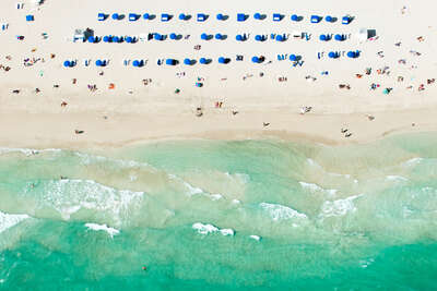 water art photography:  Blue Umbrellas Miami by Tommy Clarke